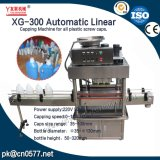 Macchina di coperchiamento lineare automatica Xg-300 per il detersivo