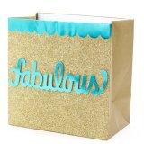 El bolso hecho a mano del regalo tiene fondo del brillo del oro, bolso de papel del regalo, bolso de papel de Kraft, bolso de papel de compras