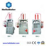 El empacado de hidráulicas verticales pulsando empacadora