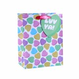 塗被紙の美しい女の子のハンドバッグ甘いキャンデーのショッピングギフトの紙袋