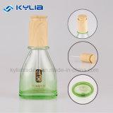 bouteille en verre verte de empaquetage cosmétique du gradient 30ml avec le chapeau en bois pour l'huile essentielle