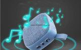 O pano de linho esquadrado cobriu o mini altofalante portátil do móbil de Bluetooth