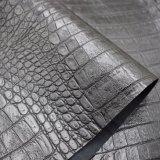 La pelle nera del coccodrillo di colore gradice il cuoio artificiale dell'unità di elaborazione, cuoio del sacchetto