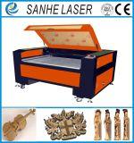 Máquina de estaca da gravura do gravador do laser do CO2 para a venda plástica de borracha de madeira de Glsaa
