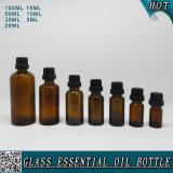 Frasco de petróleo essencial de vidro ambarino com o tampão plástico preto