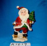 Antiker Weihnachtsmann mit Feiertags-Baum-Dekoration