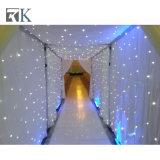 Iluminar acima a decoração do casamento do contexto da cortina da estrela do diodo emissor de luz de pano