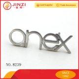 Jinziのハンドバッグのためのカスタム金属のロゴの版、金属の文字のロゴおよび衣類