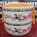 Caja de almuerzo de acero inoxidable con exterior de cerámica y diseño elegante