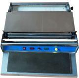 L'alimentation manuelle des bacs de la machine d'étanchéité (HW-450)