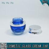 銀製の帽子が付いている50g 30g 20gの青い装飾的なガラスクリーム色の瓶