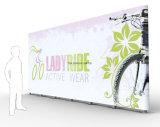La publicité en gros de promotion de matériel de cabine d'exposition de cabine de maille de vinyle de drapeau de tissu de salon d'usine de la Chine sautent vers le haut le présentoir de mémoire