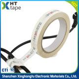 Sola cinta adhesiva echada a un lado del embalaje de lacre del aislante eléctrico