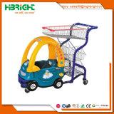 Carretilla que hace compras de los niños del supermercado con el asiento del bebé