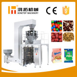 Il sale del granello dello zucchero del caffè scheggia la macchina per l'imballaggio delle merci verticale a scatti Nuts dello spuntino dei fagioli delle patatine fritte delle date del popcorn del manzo del grano del cioccolato del riso