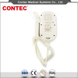 Détecteur foetal/Doppler-Contec de coeur de bébé tenu dans la main de Digitals