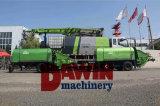 Máquina de pulverização concreta molhada no caminhão com colocação dos braços do crescimento