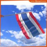 Douane die de Hand van Thailand merken - gehouden Vlaggen voor de Gebeurtenissen van Sporten