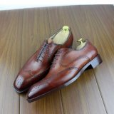 Les hommes de luxe en cuir fabriqués à la main ont fait le cuir de vache à qualité de chaussures