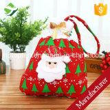 Il partito del regalo della caramella di natale insacca l'ornamento del Babbo Natale del presente della decorazione di natale