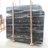黒く白い縞の大理石の石、黒い大理石、銀製のドラゴンの大理石