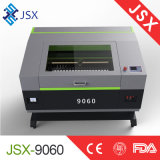 切断の彫版レーザー機械を切り分けるJsx9060 80Wファブリック革アクリルのパネル