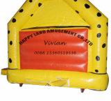 Bouncer gonfiabile di colore giallo con la piccola trasparenza