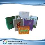 Sac de transporteur de empaquetage estampé de papier pour les vêtements de cadeau d'achats (XC-bgg-002)