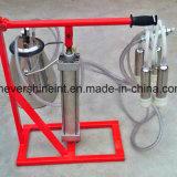 E opere a máquina de ordenha do cilindro para a vaca ou ovelhas Ordenhador