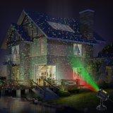 赤いおよび緑のクリスマスの庭のレーザー光線
