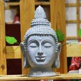 Mestiere religioso che intaglia la decorazione capa del giardino del Figurine del Buddha