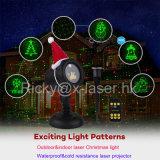 Luz de Natal ao ar livre clara do laser da estrela com a caixa de cor para o presente
