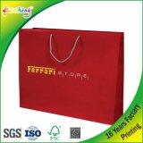 De façon unique un logo personnalisé couleurs imprimées un sac de shopping / sac de papier avec poignée de ruban