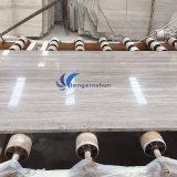磨かれた薄い灰色の木製の大理石表