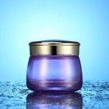 クリーム色の瓶が付いているガラス装飾的な瓶