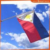 El poliéster Mini celebró la Copa Mundial de Stick agitando la mano la bandera nacional de Filipinas