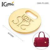 La pendaison en cuir forme ronde de gros de l'étiquette de sac à main en plaqué or