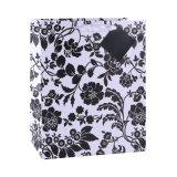 花およびプラント黒い文房具の店のギフトの紙袋