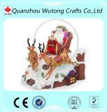 Le père noël s'asseyant avec le globe de neige de postes de Noël de résine de renne