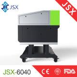 Jsx-6040, welches das Zeichen bildet das Nichtmetall schnitzt CNC-Stich-Ausschnitt-Maschine bekanntmacht