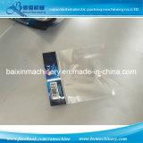La bolsa de plástico lateral impulsada por motor serva del lacre OPP que hace la máquina