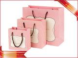 Sacco di carta d'acquisto di colore rosa del sacco di carta dei vestiti dalle donne