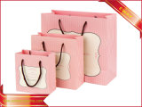 Frauen-Kleid-Papierbeutel-Rosa-kaufender Papierbeutel