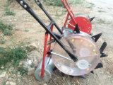 기계를 설치하는 수동 옥수수 파종기 비료