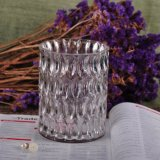 大型の彫面を切り出されたガラス蝋燭の瓶