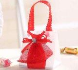 De niet-geweven Handtas van Stoffen met de Dozen van de Zak van de Doos van de Chocolade van het Suikergoed van de Kleding voor de Baby van de Verjaardag van de Partij van het Huwelijk overgiet de Giften van Gunsten