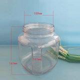 Bottiglia di vetro chiusa ermeticamente del miele con il coperchio di vetro