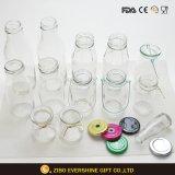 Botellas de leche de cristal de la venta barata del fabricante con los casquillos