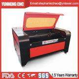 Machine de gravure en bois acrylique de laser de cuir de forces de défense principale