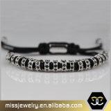 Nuovi braccialetto della corda dell'involucro degli uomini intrecciato del rame di arrivo branelli con il diamante di Zircon
